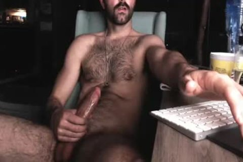 hairy Chest guy stroking His large pecker And Shooting large Load Of sperm